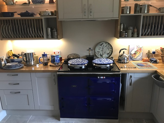 A fully restored four oven Aga with blue enamel